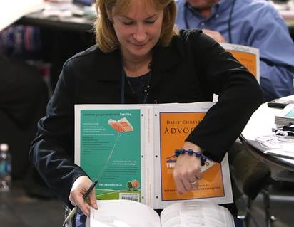 Jean Hawxhurst, delegate from the Kentucky Conference, follows the afternoon session of calendar items and petitions at the 2016 United Methodist General Conference in Portland, Ore. Photo by Kathleen Barry, UMNS.