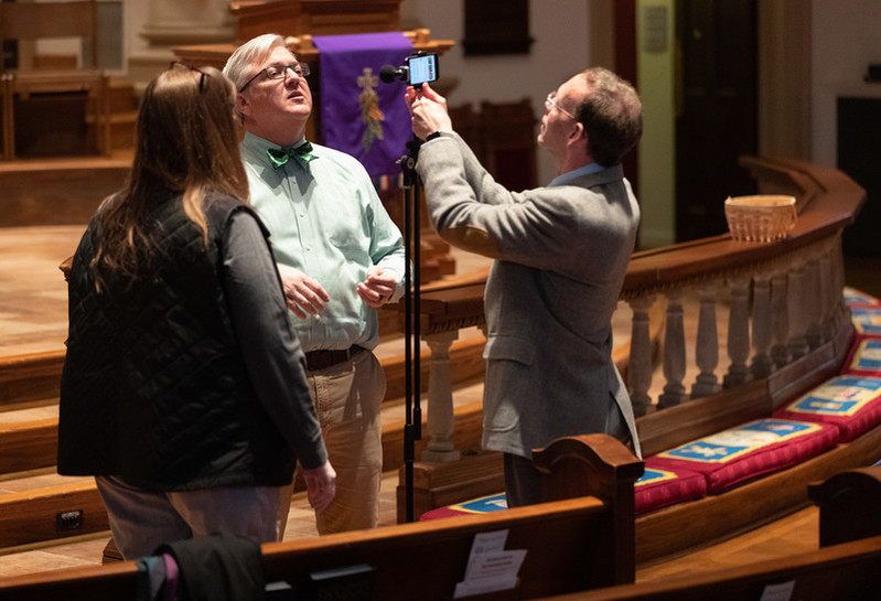 Volunteer Mike Graves (right) sets the camera to livestream a worship service from Belmont United Methodist Church in Nashville, Tenn. Helping prepare are Cindy Caldwell (left) and the Rev. Paul Purdue, Belmont's senior pastor. Photo by Mike DuBose, UM News.