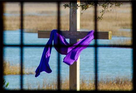 A Lenten cross at Belin Memorial United Methodist Church is visible through a window in Murrells Inlet, South Carolina. Photo by Austin Bond.