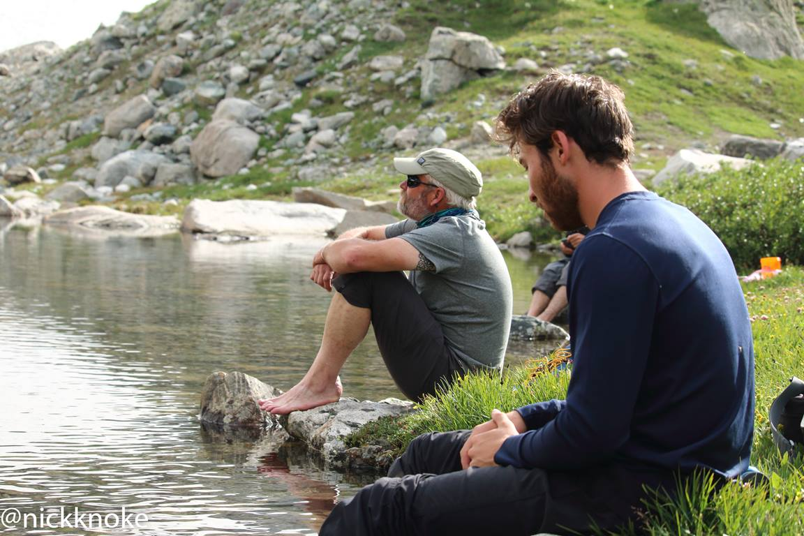 Hikers rest at Elk Lake during a Summit for Soldiers expedition to climb the tallest mountain in WY. Photo by Nick Knoke.