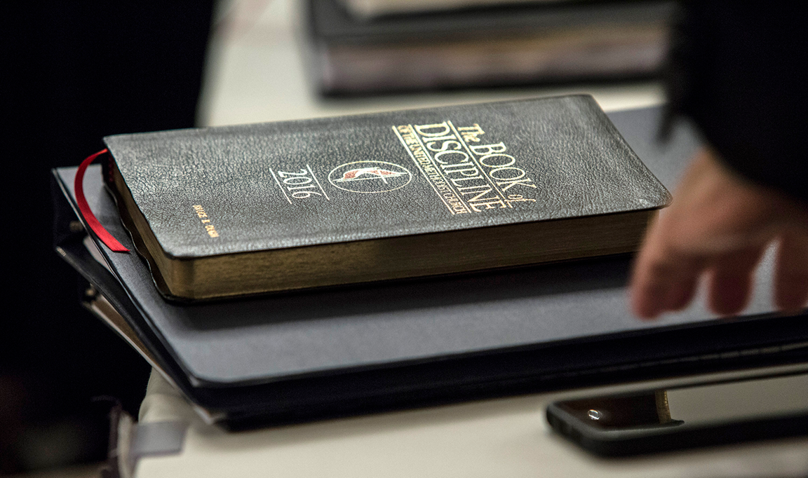 A copy of Bishop Bruce R. Ough's Book of Discipline rests on a table during an oral hearing on May 22 in Evanston, Ill. The United Methodist Judicial Council, the denomination's top court, heard arguments regarding a request from the Council of Bishops for a ruling on whether United Methodist organizations, clergy or lay members can submit petitions for the special General Conference in 2019. The hearing was part of the court's May 22-25 special session. Photo by Kathleen Barry, UM News.