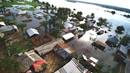 An aerial view of houses engulfed by water in Kindu, Congo. Torrential rains caused the Congo River to overflow in April, affecting more than 10,000 households in Kindu. Photo by Chadrack Tambwe Londe, UM News.