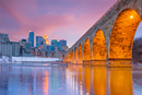 A view of the Minneapolis skyline and the Stone Arch Bridge. (Canva Pro Stock Media/Getty Images Pro)