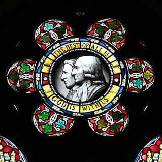This stained glass window at Wesley Memorial Methodist Church in Epworth, England features John and Charles Wesley. Photo by Kathleen Barry, United Methodist Communications