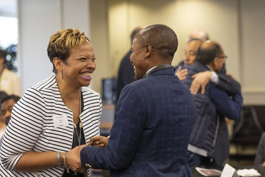 Bishop Tracy Malone greets Kitete ka Kempa Prosper during a Connectional Table meeting held at United Methodist Discipleship Ministries in Nashville, Tenn., April 2. Photo by Kathleen Barry, UM News.