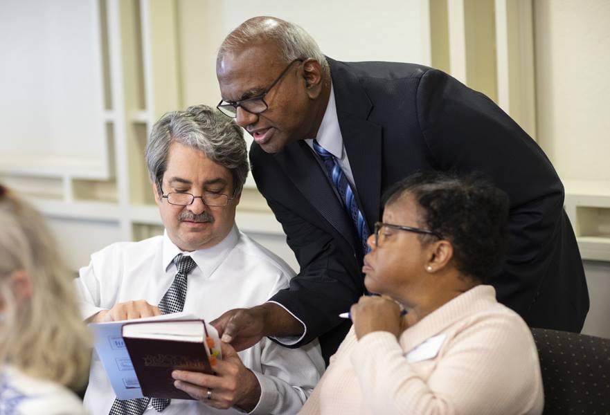 General Council of Finance and Administration members (from left) Rick King, A. Moses Kumar, and Sharon Dean engage over numbers during the Connectional Table meeting held at United Methodist Discipleship Ministries in Nashville, Tenn., April 2. King is chief financial officer, Kumar is general secretary and treasurer and Dean is chief officer of communications and marketing. Photo by Kathleen Barry, UM News.