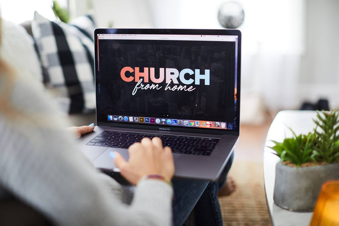 A woman watches a church worship service from home. Image by Prixel Creative, Lightstock.com.