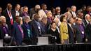 Bishops join hands in prayer during the 2019 United Methodist General Conference in St. Louis. In most cases, bishops who planned to retire this year or early next year are staying until new bishop elections can be held. File photo by Kathleen Barry, UM News.