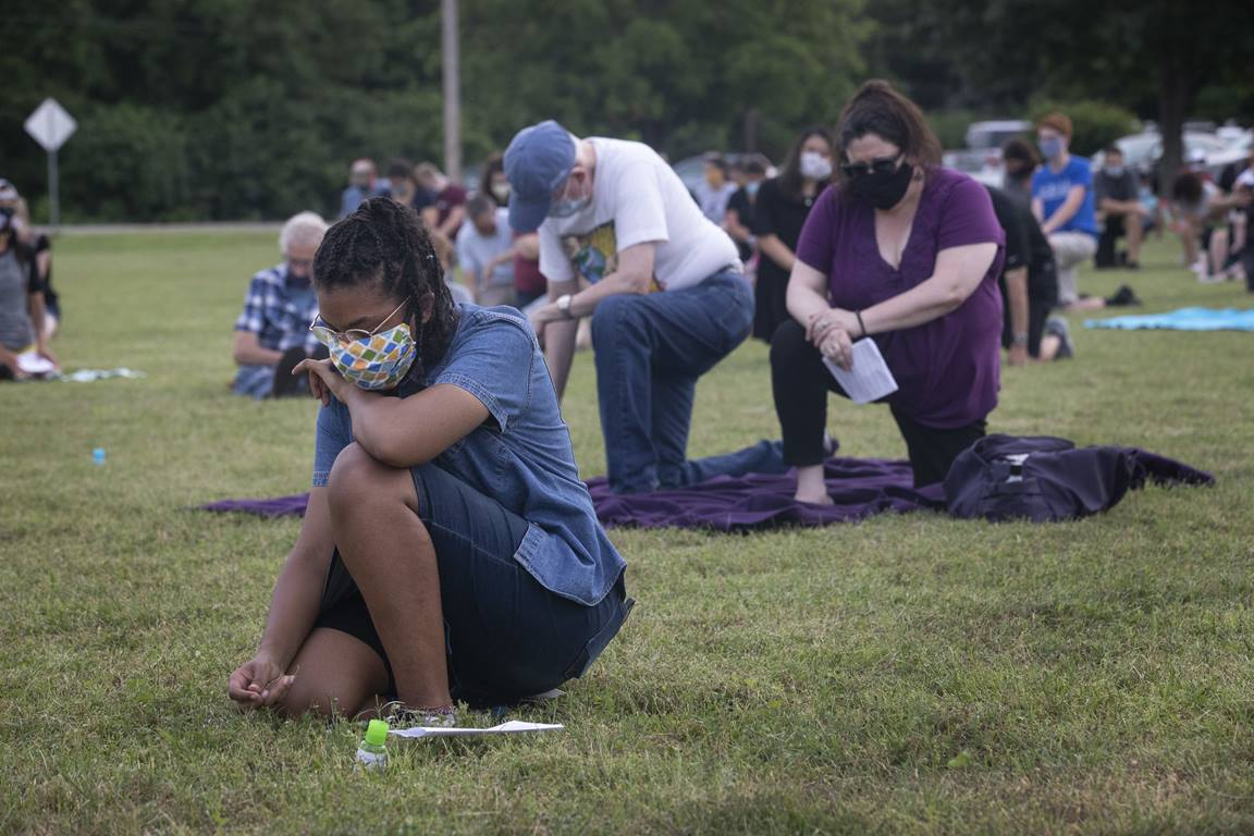 Maya Cunningham, 16, and others kneel in silence for 8 minutes in honor of George Floyd during an ecumenical prayer service on June 5, 2020 at Belle Meade United Methodist Church in Nashville, Tenn. Cunningham is from First United Pentecostal Church in Nashville. Photo by Kathleen Barry, UM News.