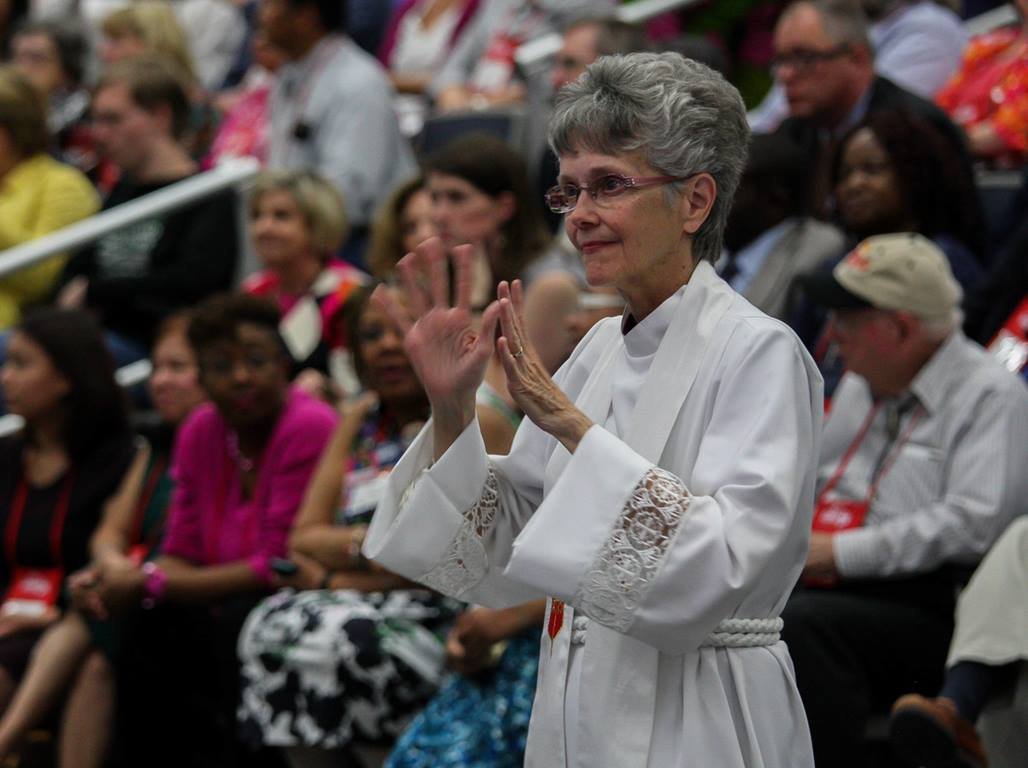 Bishop Peggy Johnson, now president of the Northeastern Jurisdiction College of Bishops, signs a song during the 2016 General Conference. Johnson leads the Philadelphia Area. Photo by Maile Bradfield, UM News.