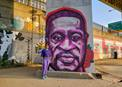 Western Pennsylvania Area Bishop Cynthia Moore-Koikoi stands in front of an image of George Floyd painted on an overpass support in Pittsburgh, Penn. Floyd, a black man, was killed in Minneapolis, Minn., when a white police officer knelt on his neck for nearly 9 minutes. Photo by Jackie Campbell, Western Pennsylvania Conference