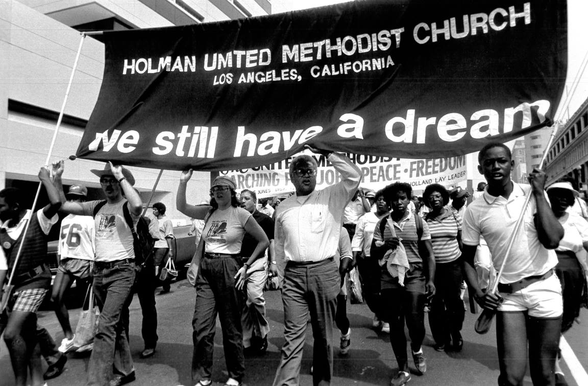 March for Peace, Jobs and Freedom on the 20th anniversary of the original march in Washington, D.C. 1984. The Rev. James Lawson (center) leads a group from Holman United Methodist Church in Los Angeles. Photo by John C. Goodwin, United Methodist Board of Global Ministries.