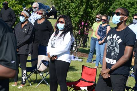 """Worshippers join in a song during an outdoor service entitled """"A Call to Prayer for Social Justice, Reconciliation and Healing"""" at St. John AME Church in Aurora, Ill. File photo by Al Benson."""