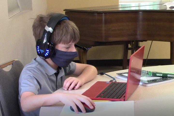 Neighborhood children attend a virtual school learning pod at Denton's Chapel UMC in Nashville, Tennessee