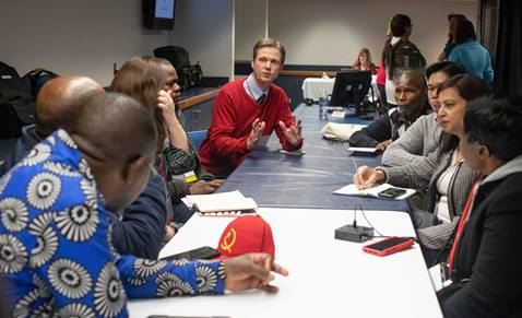 Tim Tanton, chief news and information officer for United Methodist Communications, shares updates with African communicators during the 2019 United Methodist General Conference in St. Louis. Directors of UMCom met to listen to concerns and share information. (Photo by Kathleen Barry, UM News)