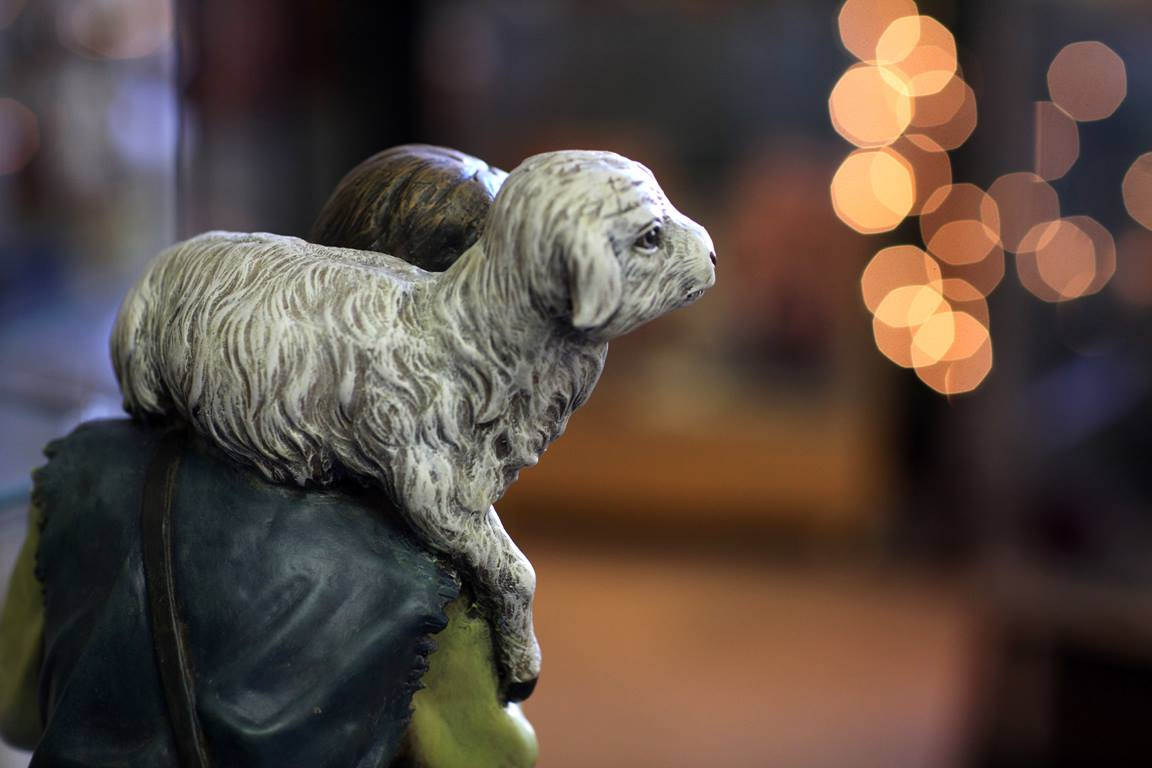 A nativity figure of a shepherd holds a young lamb. Photo by Kathleen Barry, UMNS