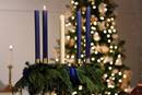 A single lit candle in a wreath signifies the first week of Advent. In the midst of the COVID-19 pandemic and other challenges, United Methodist churches are thinking creatively for the seasons of Advent and Christmas. Photo of Glendale United Methodist Church in Nashville, Tenn., by Steven Kyle Adair, United Methodist Communications.