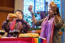 The Revs. Martha E. Vink (left) and Alka Lyall lead a Holy Communion service during an Advent gathering in December 2019 at St. Andrew United Methodist Church in Highlands Ranch, Colo. The two are among the collaborators organizing the Liberation Methodist Connexion, a new denomination that held an online launch event on Nov. 29. Photo courtesy of LMX.