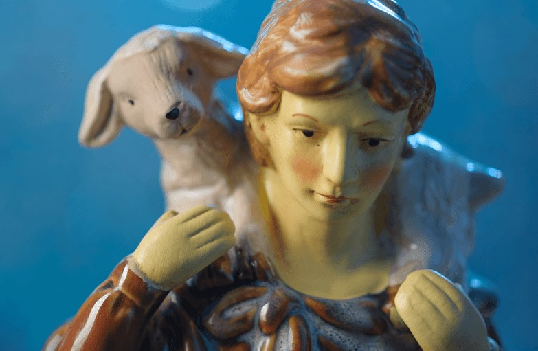 Nativity set figurine of a shepherd holding a lamb while looking for the Christ child. Courtesy of the Lewis Center for Church Leadership.
