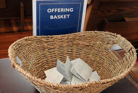 View of the offering basket at First United Methodist Church of Sulphur Springs, Texas, in 2020. Overall collection rates for general church ministries were higher than feared, but COVID-19 still presents a great deal of uncertainty for church financial leaders. File photo by Sam Hodges, UM News.
