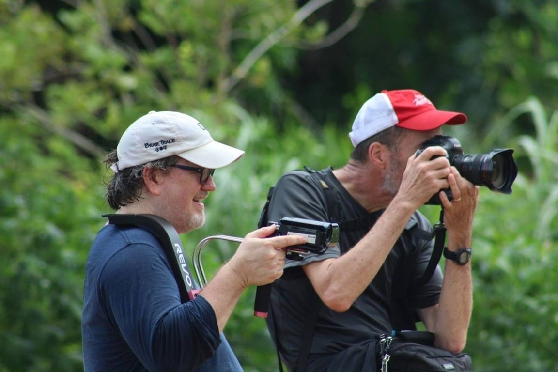 Joey Butler (L) and Mike DuBose (R) working together to capture imagery during pre-pandemic days. (Photo by E Julu Swen, UM News.)