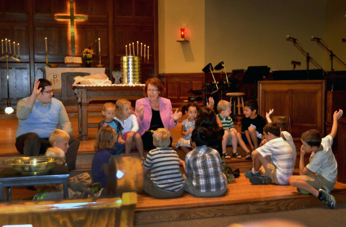 The Rev. Kathy Hartgraves instructs the children during the Aug. 4 worship at First United Methodist Church in Mitchell, S.D. Photo courtesy of the Dakotas Conference. This photo was taken pre-COVID.