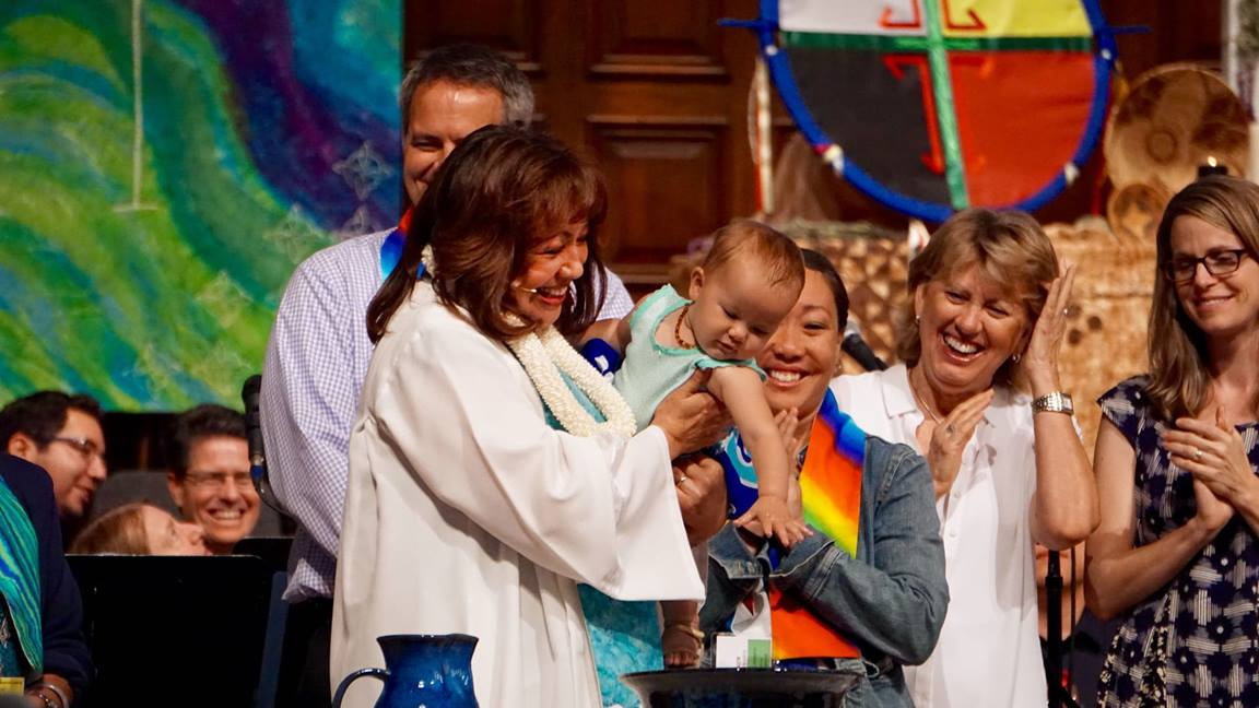 Bishop Minerva Carcaño baptizes the daughter of Revs. Allison and Andrew Schwiebert during the California-Pacific Annual Conference. Photo by James K. Kang, California-Pacific Conference.