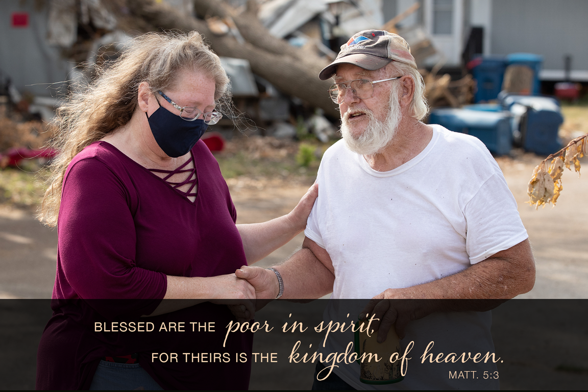The Rev. Catie Newman prays with John Wm. Weaver in front of a neighbor's wind-damaged home while a United Methodist volunteer team makes emergency repairs to his roof in Marion, Iowa. Weaver's mobile home was severely damaged during a derecho windstorm in August. Newman is the disaster response coordinator for the Iowa Conference. Photo by Mike DuBose, UM News.