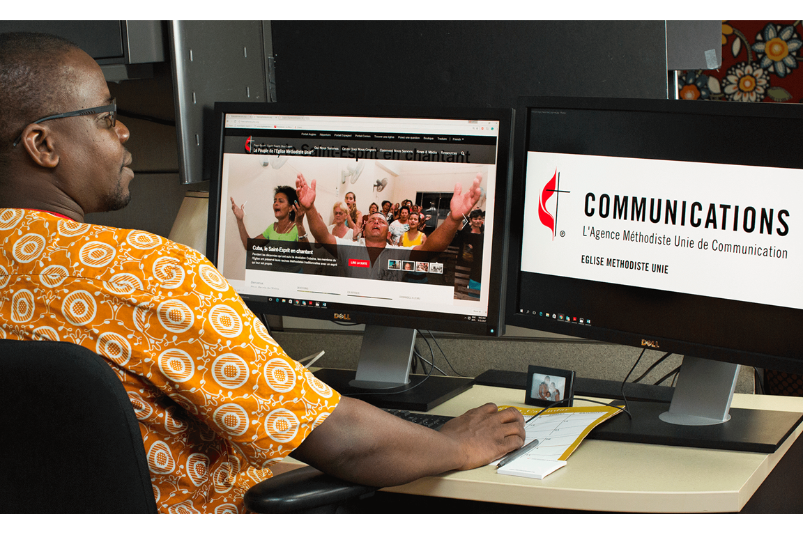 Isaac Broune, intern with the French Content Team at United Methodist Communications, works on the website of the French portal. Broune is a Vanderbilt University Divinity student from Côte d'Ivoire. Photo by Kathleen Barry, United Methodist News Service