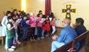 """With the help of an UMCOR grant, the Methodist Church of Peru remodeled the Church of Miramar in the San Miguel District of Lima to provide a shelter and service hub for migrants arriving from Venezuela. Venezuelan children in this """"House of Hope"""" gather for choir practice. PHOTO: METHODIST CHURCH OF PERU"""
