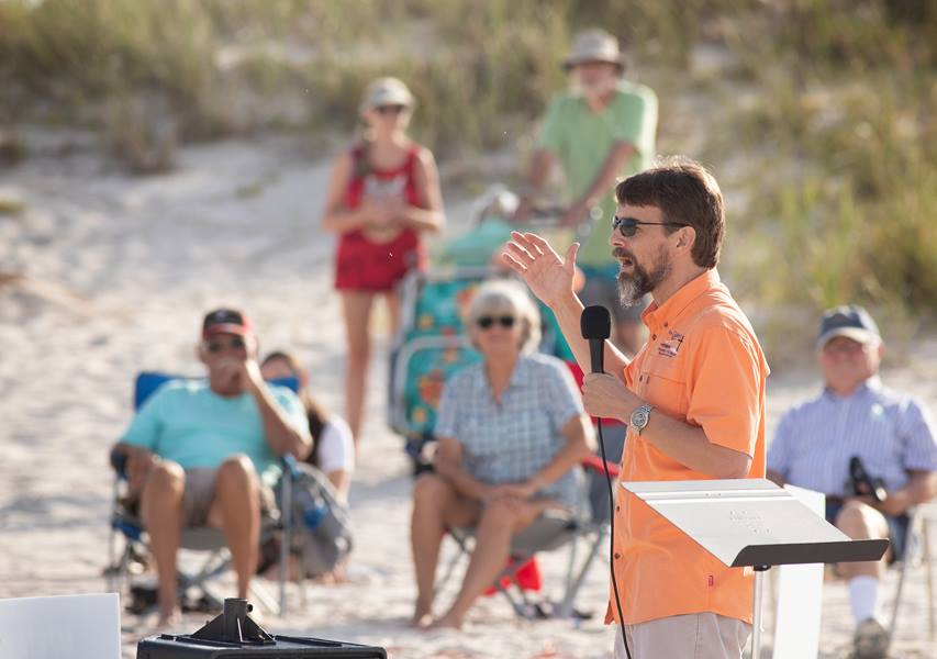 The Rev. Nolan Donald gives the sermon during the Galilean Beach service, a ministry of Foley (Ala.) United Methodist Church at Gulf State Park in Gulf Shores, Ala. Photo by Mike DuBose, UM News.