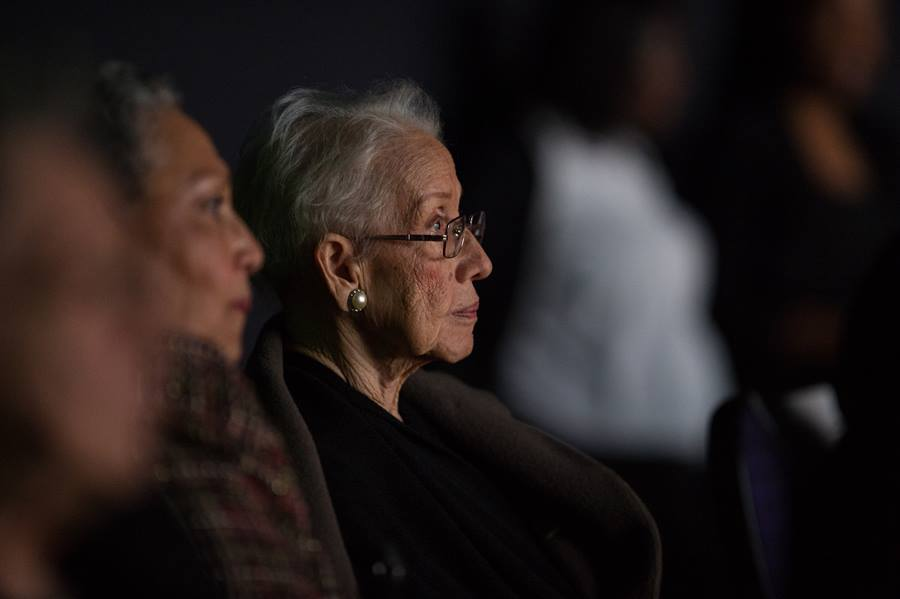 """NASA """"human computer"""" Katherine Johnson watches the premiere of """"Hidden Figures"""" after a reception where she was honored along with other members of the segregated West Area Computers division of Langley Research Center, on Thursday, Dec. 1, 2016, at the Virginia Air and Space Center in Hampton, VA. Photo courtesy of NASA."""