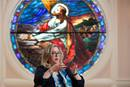 """Kellie D. Brown is the author of """"The Sound of Hope: Music as Solace, Resistance and Salvation During the Holocaust and World War II."""" She discusses the book while seated in front of a stained-glass depiction of Jesus at First Broad Street United Methodist Church in Kingsport, Tenn., where she is a member. Photo by Mike DuBose, UM News."""