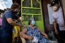 Health workers vaccinate Francia Nolasco, 78, against COVID-19 at her home in Marikina, Metro Manila, Philippines. The United Methodist Board of Church and Society in the Philippines is calling on the government to provide coherent direction in addressing the pandemic crisis. Photo by Eloisa Lopez, Reuters.