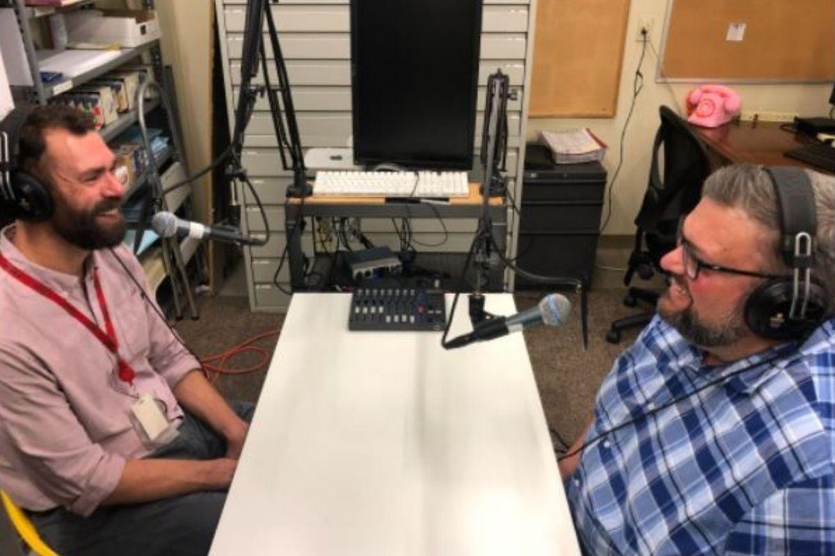 United Methodist Communications' Ryan Dunn and Joe Iovino discuss podcasting. (Photo by Crystal Caviness, United Methodist Communications.)