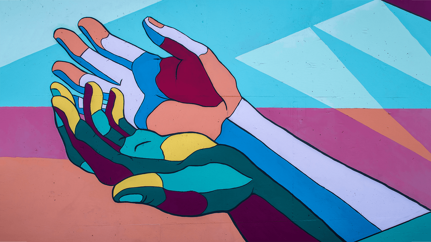George Fox University students Annabelle Wombacher, Jared Mar, Sierra Ratcliff and Benjamin Cahoon collaborated on the mural in Newberg, Oregon, that shows three pairs of hands representing giving and generosity, receiving and gratitude, and embracing. The mural is part of the Yamhill County Mural Project. Photo by Tim Mossholder on Unsplash.