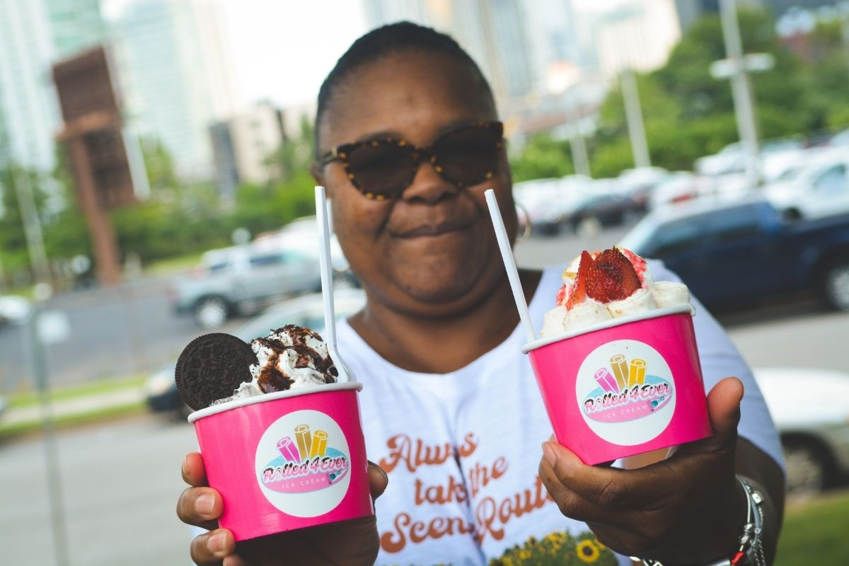 Debra Jemison shows off a couple of the yummy flavors offered by Rolled 4 Ever Ice Cream. (Photo by Aaron Crisler.)
