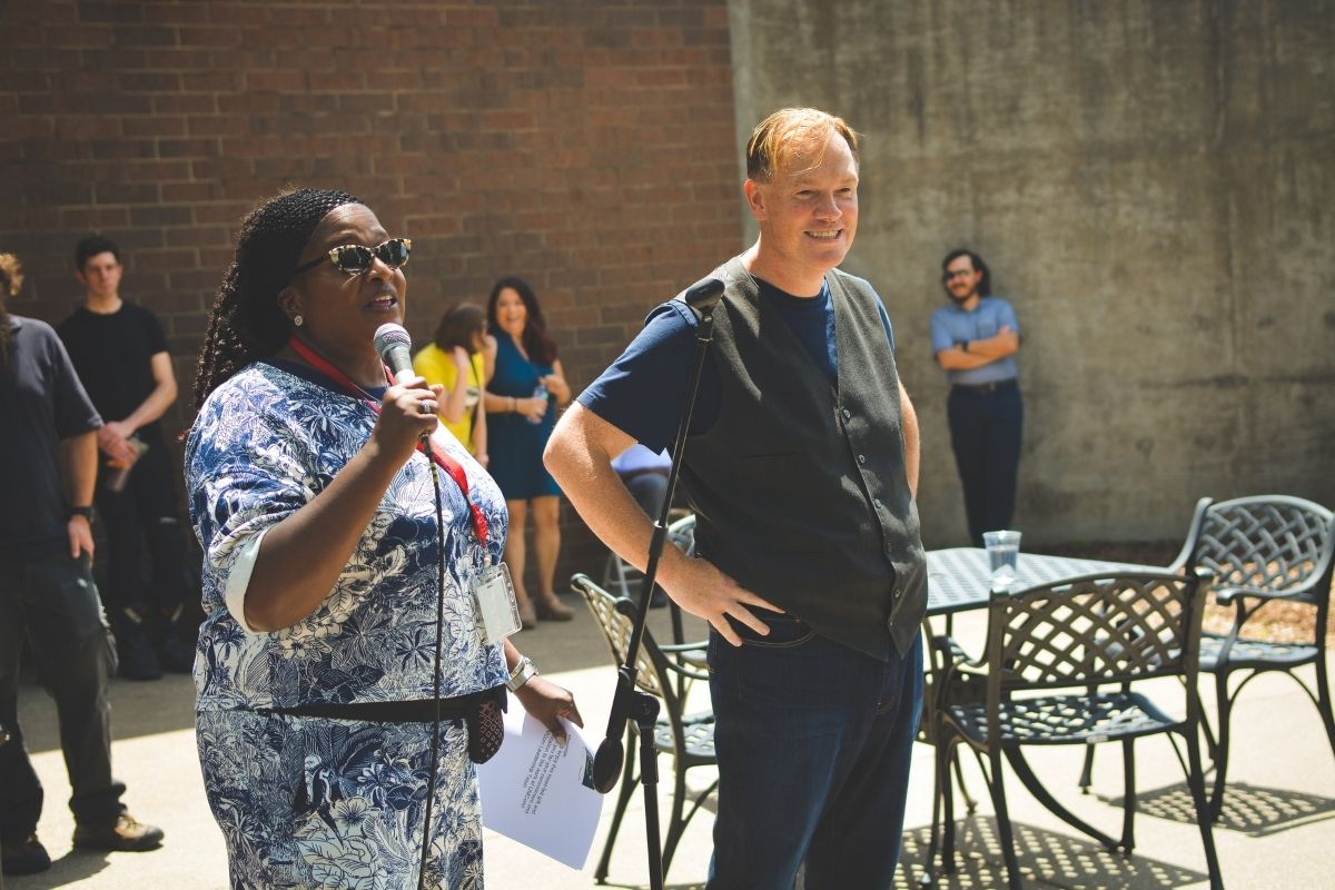Helen Allen and Dan Krause spoke to the staff during the United Methodist Communications picnic. (Photo by Aaron Crisler.)