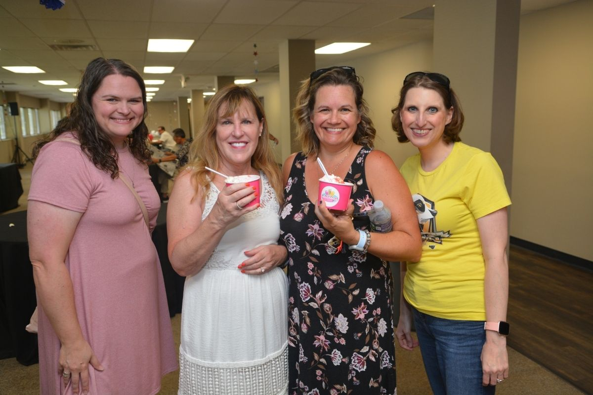 Laura Buchanan,  Diane Degnan, Christy Losee and Brenda Smotherman caught up while cooling down inside following lunch at the picnic. (Photo by Aaron Crisler.)