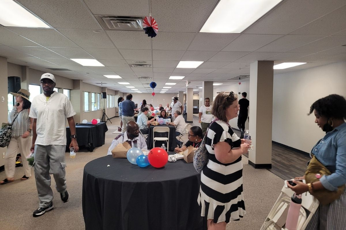A number of staff gathered inside to eat lunch and chat while escaping the heat of the day. (Photo by Brenda Smotherman.)