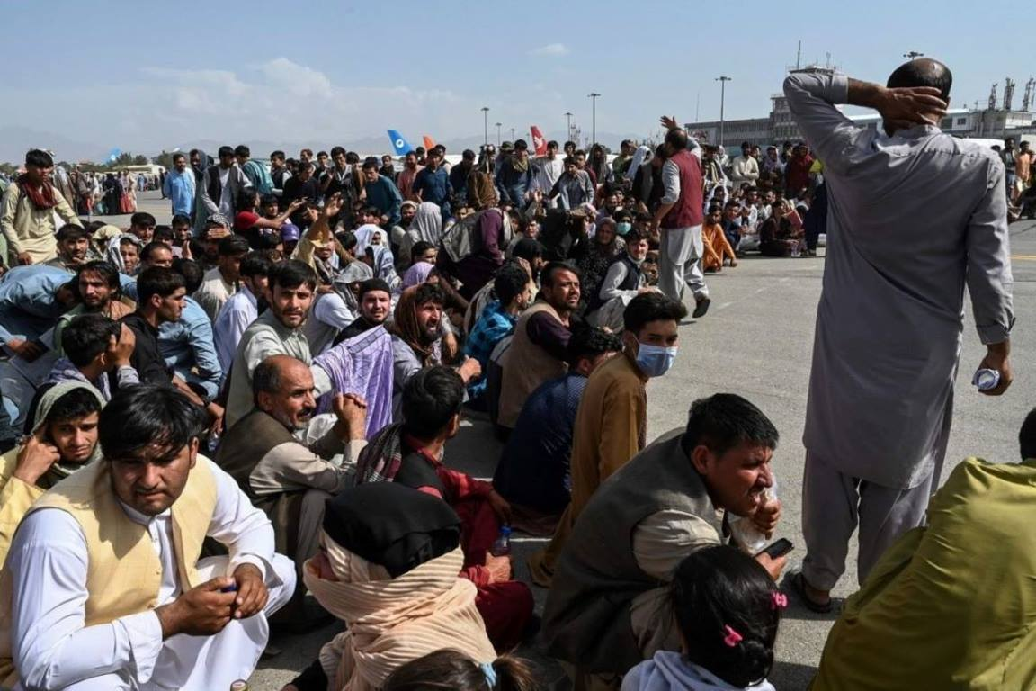 Afghans at the Kabul airport on August 18, 2021. PHOTO: SHUTTERSTOCK