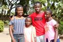 Mellan Nyagato (left) poses with her siblings in Harare, Zimbabwe. The Africa University junior is coping with her father's death from COVID-19 while studying online with her sisters. Photo courtesy of Mellan Nyagato.