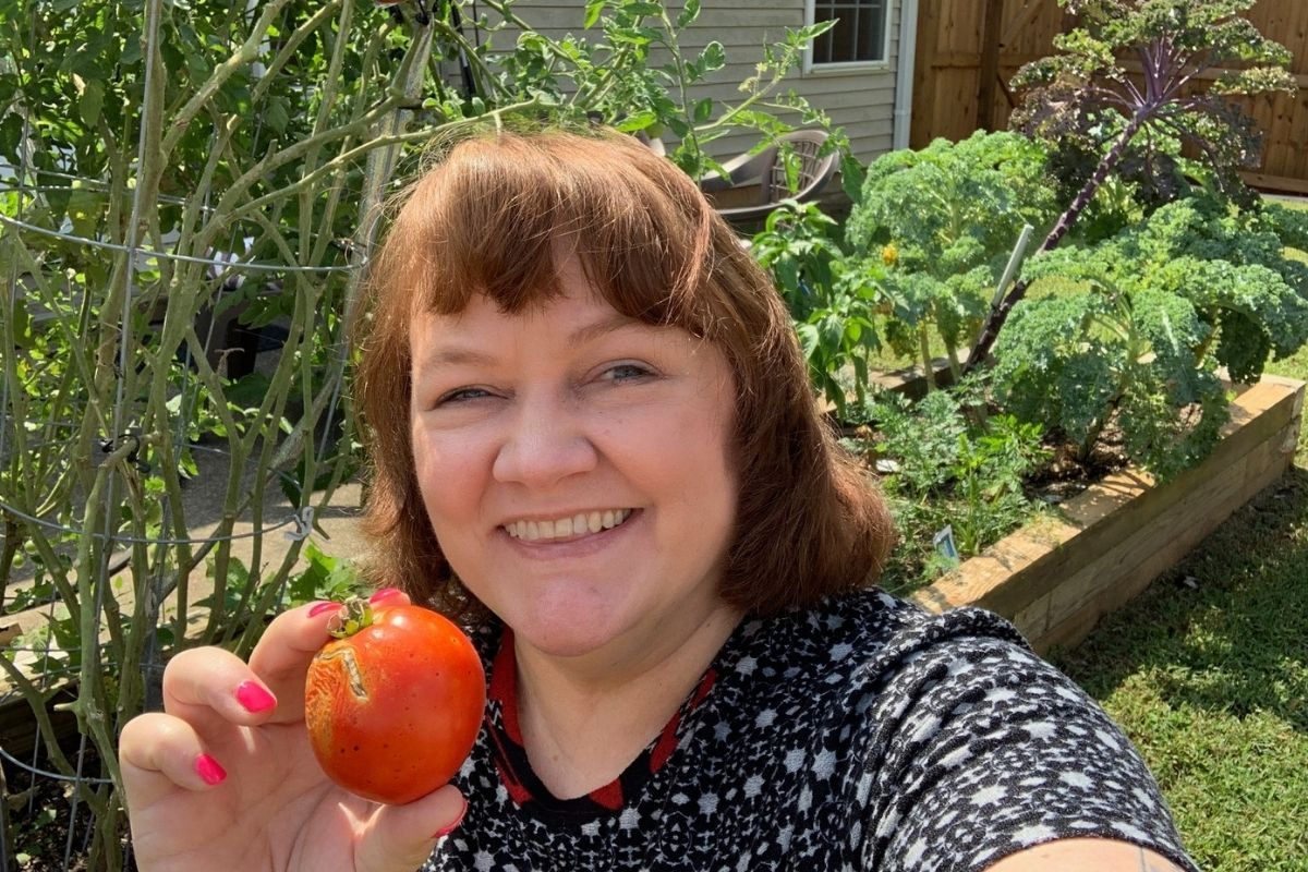 """Pam Buck's garden is bursting with kale, green beans, carrots, three varieties of lettuce and green peppers. She had so much kale that some lucky people at the agency picnic got to enjoy these veggies. Pam shares that """"This was my first gardening adventure and I know my Dad would be so proud!"""" (Photo courtesy of Pam Buck.)"""